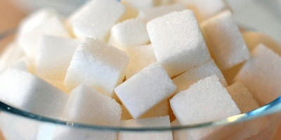 How does sugar in our diet affect our health?